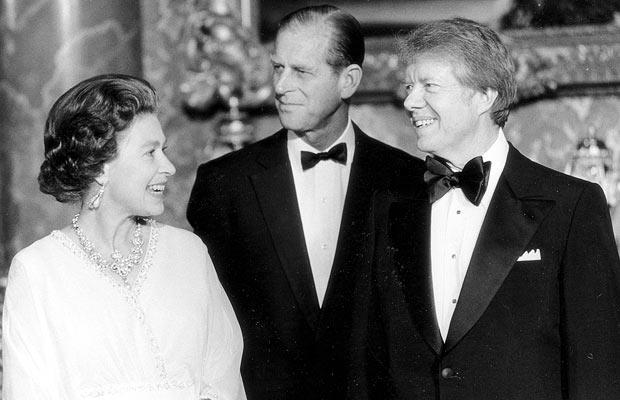 Jimmy Carter joins the Queen and Prince Philip at Buckingham Palace on 7 May 1977