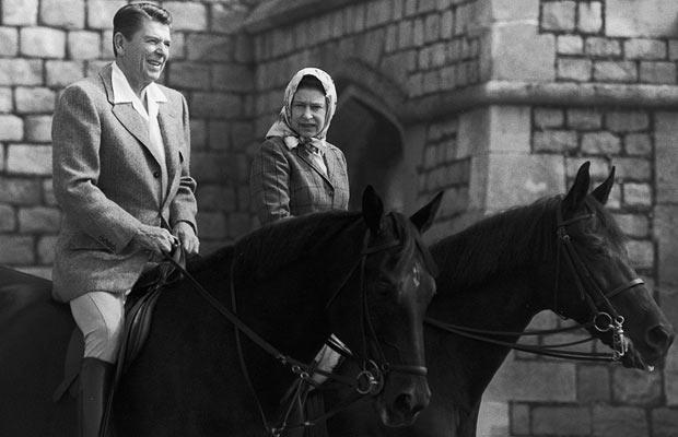 Ronald Reagan and the Queen engage in conversation while riding in the grounds of Windsor Castle on 9 June 1982
