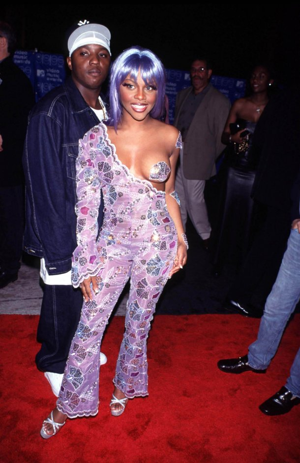 Lil' Kim was drowning in this sea of purple.