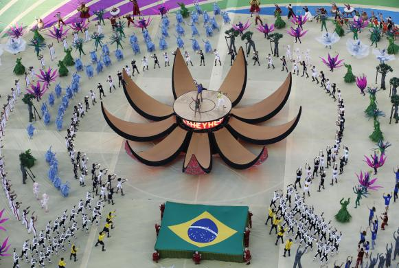 Claudia Leitte, Jennifer Lopez and Pitbull perform during the 2014 World Cup opening ceremony at the Corinthians arena in Sao Paulo