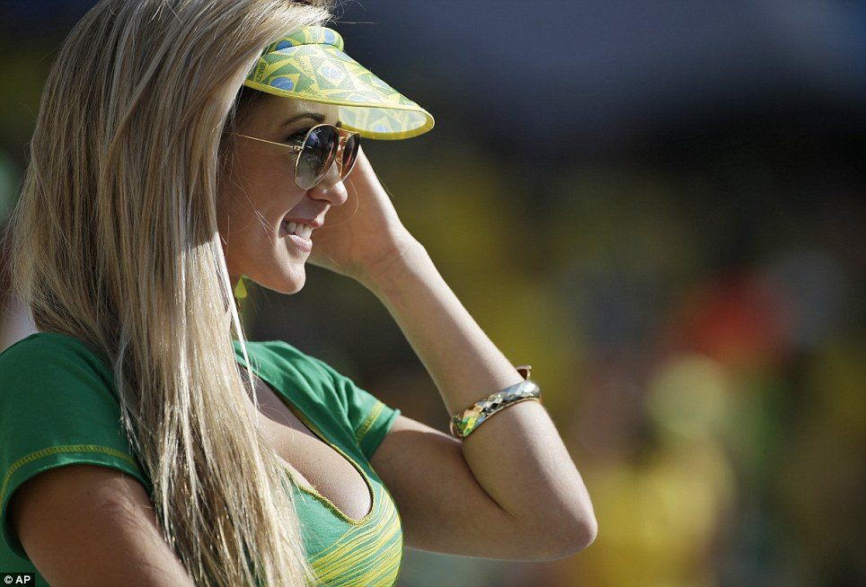 A Brazil fan waits for the start of the Group A match against Croatia