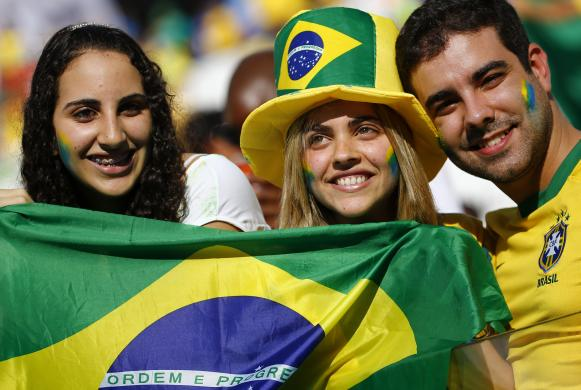 Brazilian fans pose during the opening ceremony of the 2014 World Cup at the Corinthians arena in Sao Paulo