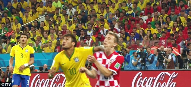 Luka Modric takes one in the face from Neymar during the first half