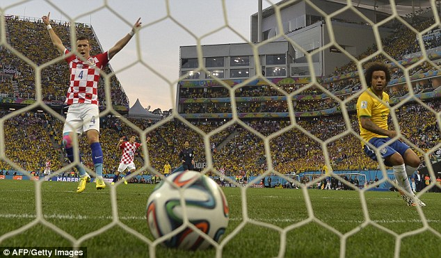 Marcelo (right) looks aghast as his own goal gives Croatia the lead, much to the delight of Ivan Perisic