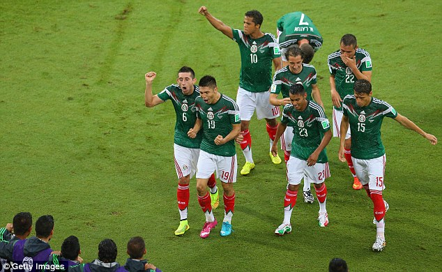Mexico's players celebrates Peralta's crucial winning goal on Friday