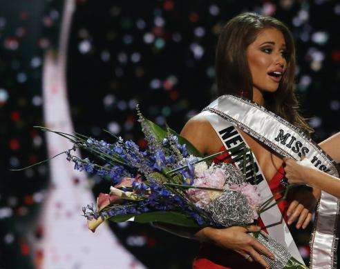 Miss Nevada Nia Sanchez reacts to winning the 2014 Miss USA beauty pageant in Baton Rouge, Louisiana