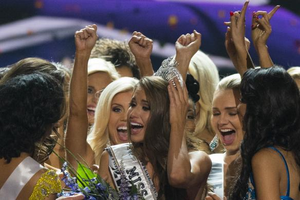 Fellow contestants celebrate with Miss Nevada Nia Sanchez after she won the 2014 Miss USA beauty pageant in Baton Rouge, Louisiana