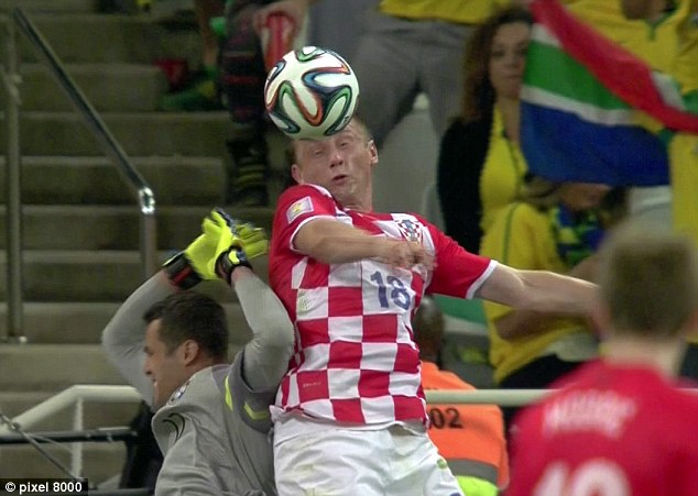 Olic jumped with his hands by his sides and headed the ball
