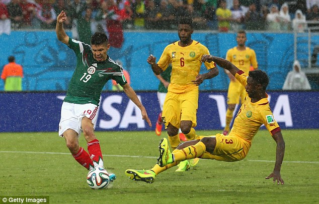 Oribe Peralta (left) gives Mexico the lead in the 61st minute