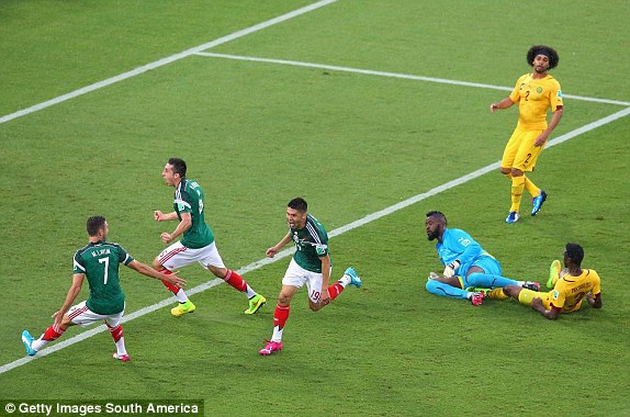 Oribe Peralta of Mexico (cente) celebrates his goal