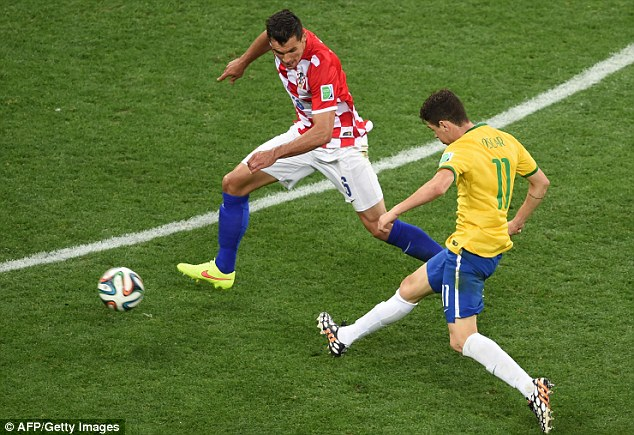 Oscar curls in the third Brazil goal