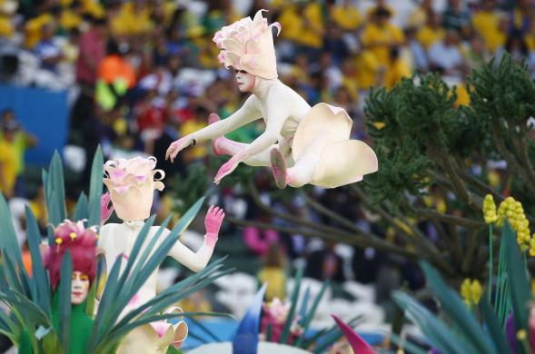 Performers participate in the opening ceremony of the 2014 World Cup at the Corinthians arena in Sao Paulo