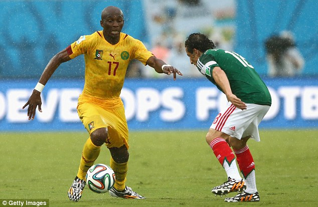 Stephane Mbia (left) controls the ball as Andres Guardado gives chase during the first half