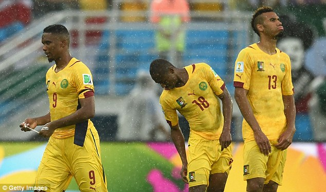 The Cameroon players stand dejected after going down 1-0 against Mexico