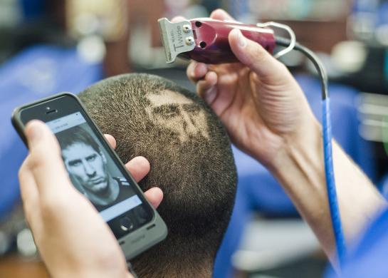 A likeness of Messi is cut onto the head of a customer at the barbershop run by hair artist and master barber Ferrel in San Antonio