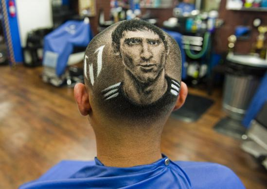An image of Messi is cut onto the head of a customer at the barbershop run by Ferrel in San Antonio