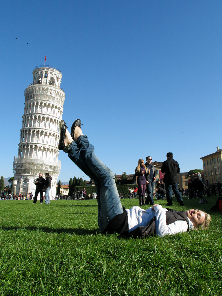 Suzi holding the Leaning Tower of Pisa, Italy