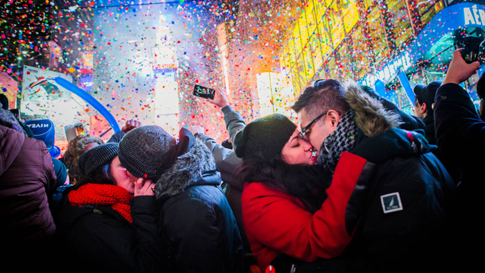 Couples kiss after midnight in Times Square during the New Year's Eve