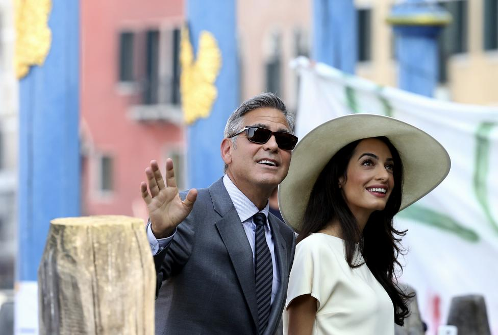 U.S. actor George Clooney and his wife Amal Alamuddin arrive at Venice city hall for a civil ceremony to formalize their wedding in Venice