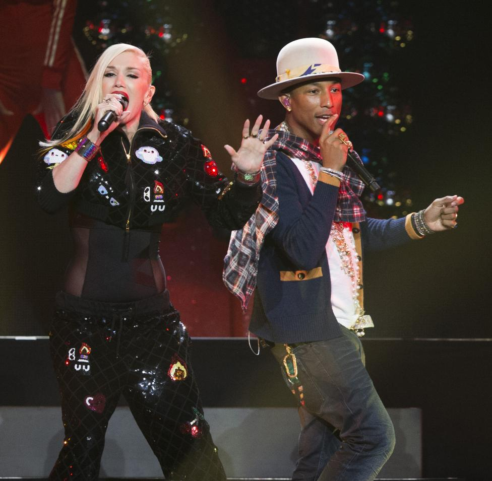 Recording artists Gwen Stefani and Pharrell Williams perform during KIIS FM's Jingle Ball 2014 at Staples Center in Los Angeles