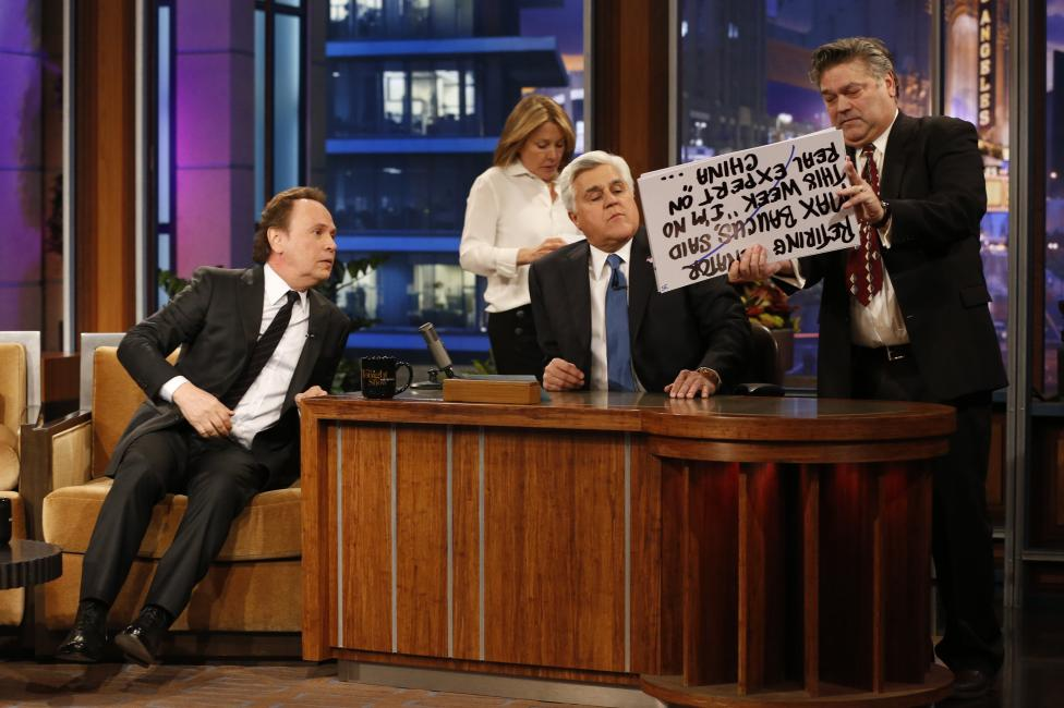 "Leno looks at cue cards with actor Crystal during a commercial break while taping the last episode of ""The Tonight Show with Jay Leno"" in Burbank"