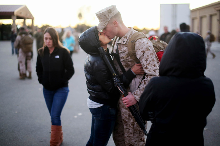 Lance Corp Bryce Lindsey kisses his wife Lydia at Camp Pendleton