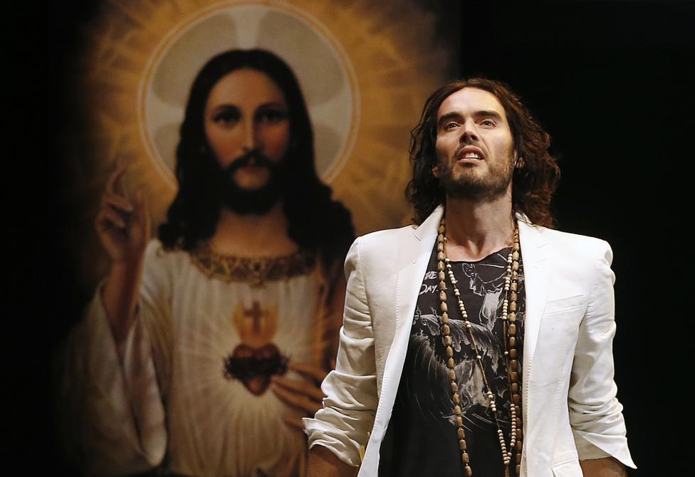 British comedian Russell Brand performs at his Messiah Complex show in London