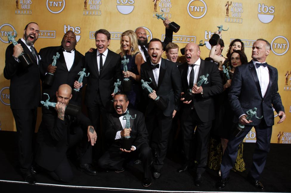 "The cast and crew of ""Breaking Bad"" pose with their award at the 20th annual Screen Actors Guild Awards in Los Angeles"