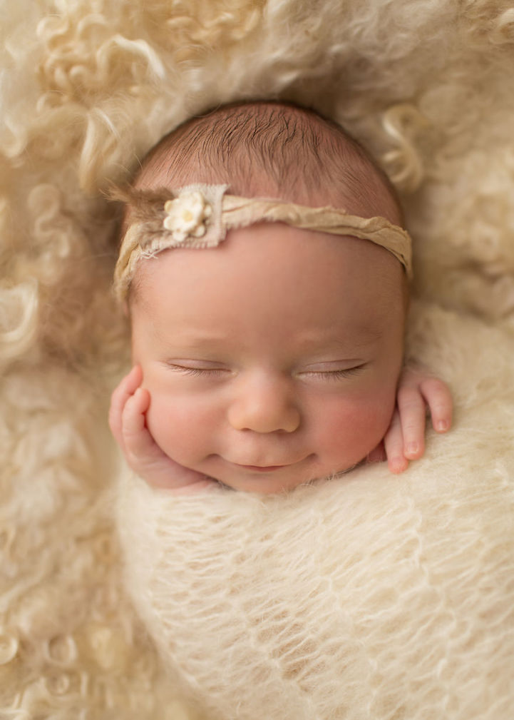 Heartwarming Portraits of Newborn Babies Smiling Sweetly