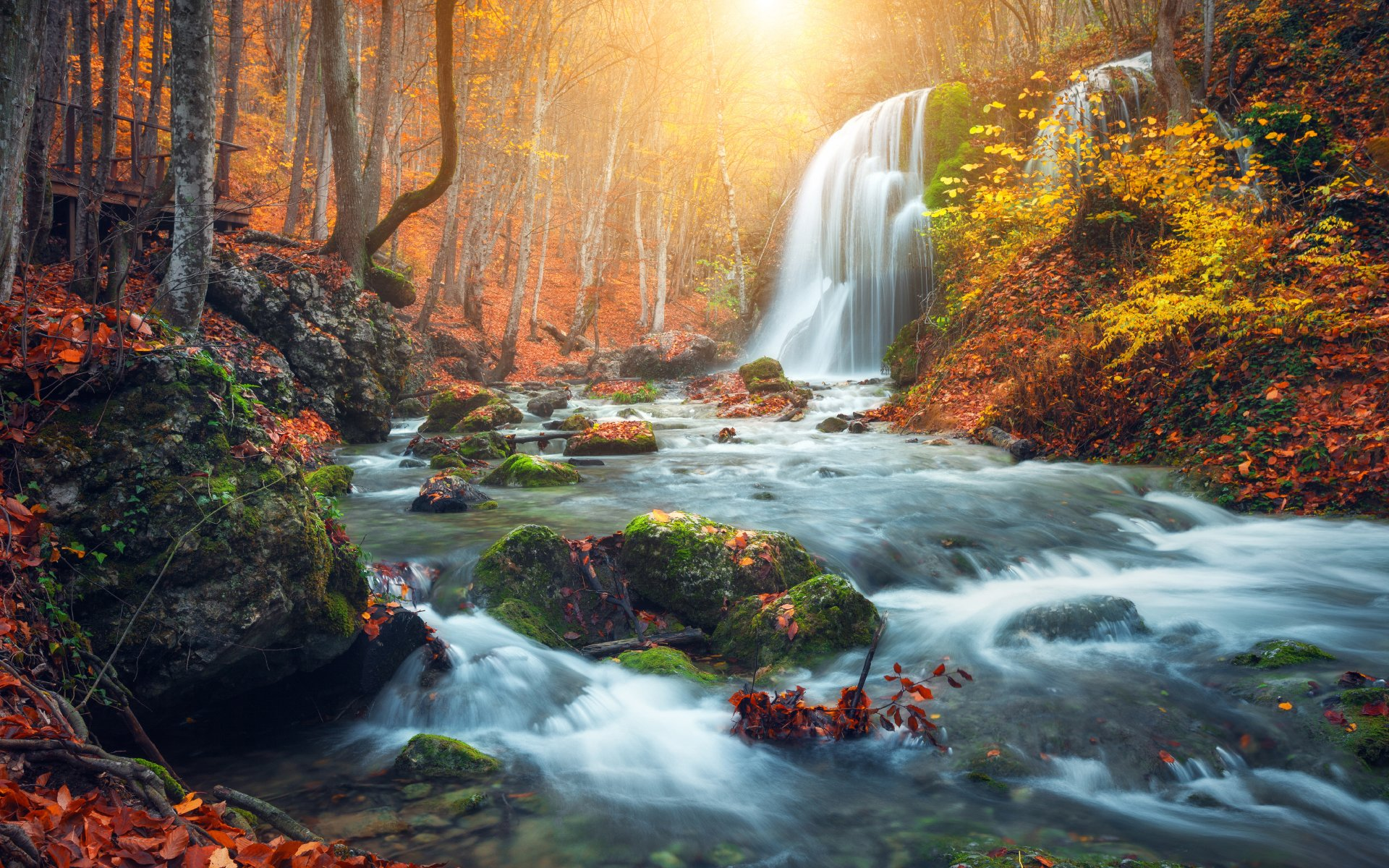 Beautiful waterfall in autumn forest in Crimean mountains