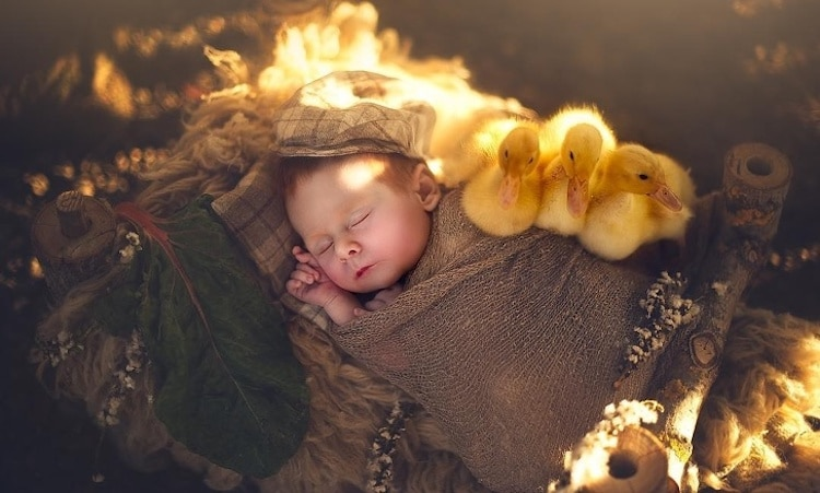 Heartwarming Photos of Newborn Babies Snuggling With Baby Animals